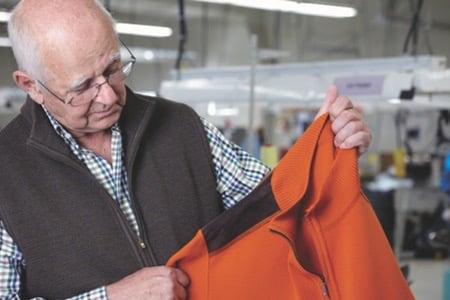 Bernhard Brenner inspecting knitwear